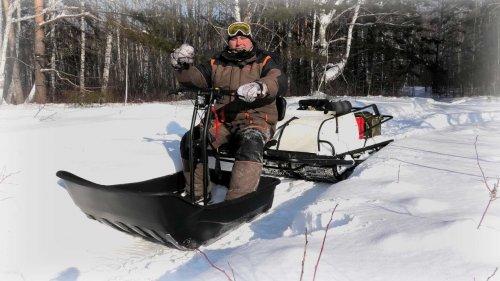 Супер Проходимый мотобуксировщик для глубокого снега Snowdog twin pro.